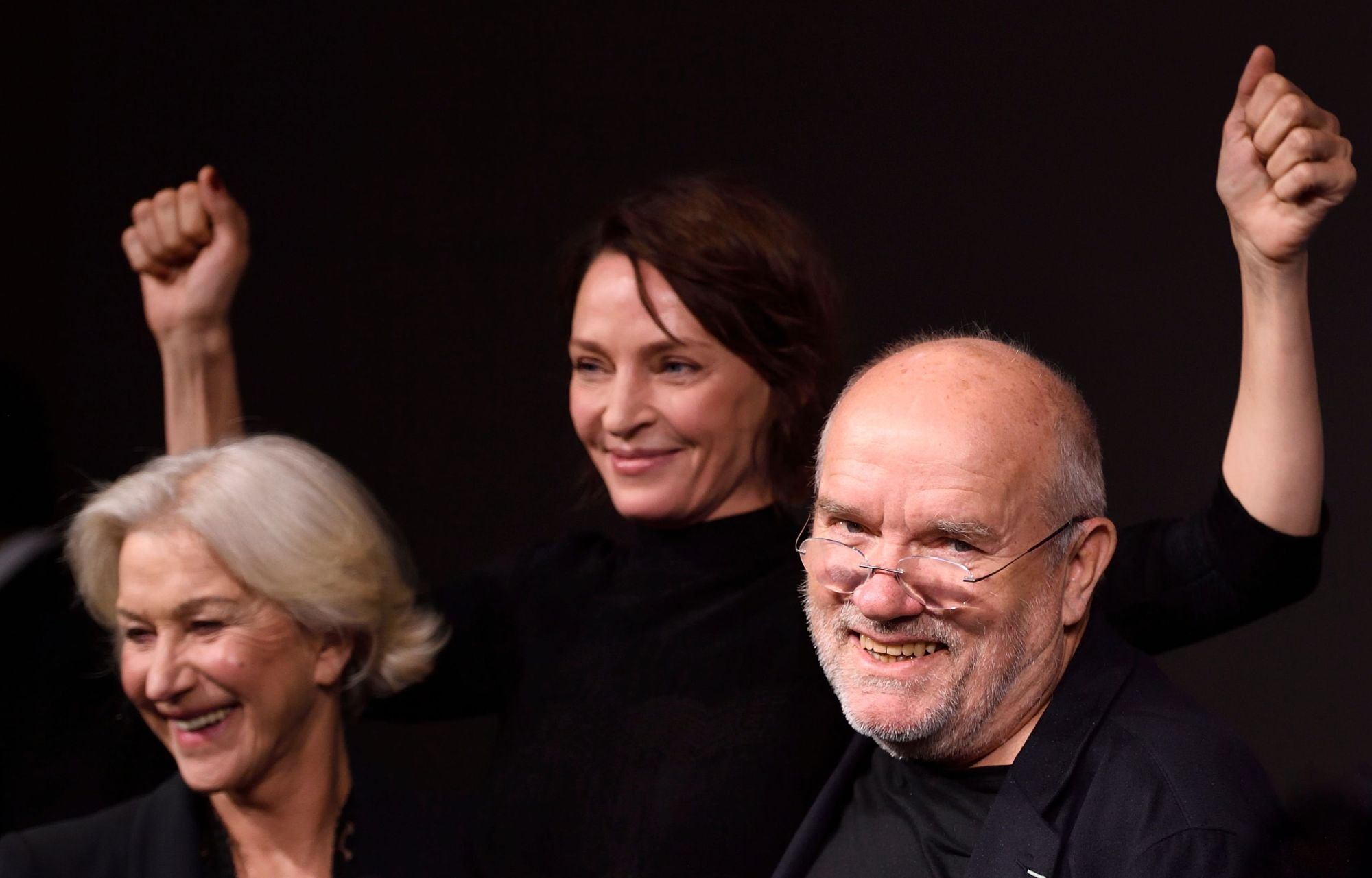 German photographer Peter Lindbergh, U.S. actress Uma Thurman (center) and British actress Helen Mirren pose during the presentation of the 2017 Pirelli calendar in Paris. Lindbergh, the German photographer credited with launching the careers of supermodels such as Naomi Campbell, Cindy Crawford and Linda Evangelista, has died aged 74, his family told AFP on Wednesday. | AFP-JIJI