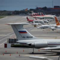 Russian military specialists arrive in Caracas to service equipment as Maduro meets Putin, Interfax reports