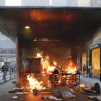 A fire set by protesters burns at an entrance to the Central MTR subway station in Hong Kong on Sept. 8. | AP