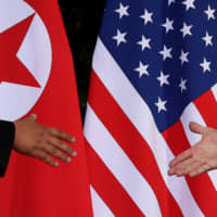 U.S. President Donald Trump and North Korea's leader Kim Jong Un meet at the start of their summit at the Capella Hotel on the resort island of Sentosa, Singapore, in 2018. | REUTERS
