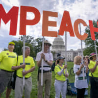 Activists rally for the impeachment of President Donald Trump, at the Capitol in Washington Thursday. Speaker of the House Nancy Pelosi committed Tuesday to launching a formal impeachment inquiry against Trump.   AP