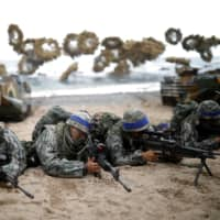 South Korean Marines take part in a joint landing drill with U.S. forces in Pohang in April 2017. | REUTERS