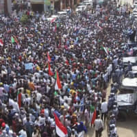 In this frame grab from video, thousands of Sudanese rally on the streets of Khartoum Thursday. The protesters demanded the sacking of the judiciary chief and the general prosecutor over their alleged ties to ousted autocrat Omar al-Bashir's government. The protesters waved Sudanese flags and marched to the presidential palace on Thursday. | AP