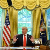 U.S. President Donald Trump updates the media on Hurricane Dorian preparedness from the Oval Office at the White House in Washington Sept. 4. Trump on Sunday tweeted that secret meetings that were to be held at Camp David with Taliban leaders and the Afghan president on Sunday had been canceled following a bombing in Kabul last week. | AFP-JIJI