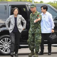 Taiwanese President Tsai Ing-wen arrives at a military base in Hsinchu, northern Taiwan, on Tuesday. | AFP-JIJI