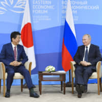 Prime Minister Shinzo Abe and Russian President Vladimir Putin hold a meeting in Vladivostok, Russia, on Thursday. | KYODO