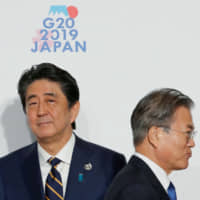 Abe to visit China in December for meeting with Premier Li Keqiang and South Korea's Moon