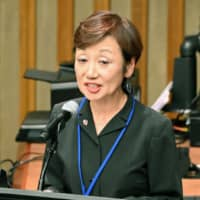 Mitchie Takeuchi delivers a speech Thursday at the U.N. headquarters in New York. | KYODO