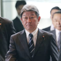 Newly appointed Foreign Minister Toshimitsu Motegi arrives at the Prime Minister's Office in Tokyo on Wednesday.   AP