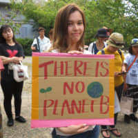 People rally in Kyoto on Friday as part of the global climate strike. | ERIC JOHNSTON