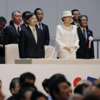 Emperor Naruhito and Empress Masako attend an opening ceremony for two cultural festivals in the city of Niigata on Monday. | KYODO