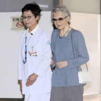Empress Emerita Michiko admitted to hospital ahead of breast cancer surgery