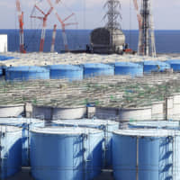 Tanks store tainted water at the Fukushima No. 1 plant in February. | KYODO