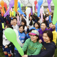 Participants of an event to promote the 'reconstruction Olympics' theme for the 2020 Tokyo Games hold balloons at the J-Village national soccer training center in the town of Naraha, Fukushima Prefecture, on March 1. | KYODO