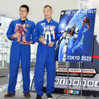 Japanese astronauts visit factory making 'Mobile Suit Gundam' models bound for space