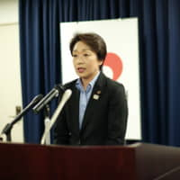 Seiko Hashimoto, the new minister in charge of the 2020 Olympic and Paralympic Games, speaks during a news conference in Tokyo on Thursday, one day after her appointment in a Cabinet reshuffle. | RYUSEI TAKAHASHI