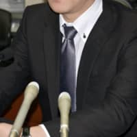 A man speaks at a news conference in Sapporo on Tuesday after the Sapporo District Court ordered a hospital operator to pay him ¥1.65 million in damages after it refused to employ him for failing to report that he is HIV-positive. | KYODO