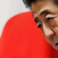 Prime Minister Shinzo Abe holds a news conference at the Prime Minister's Office in Tokyo on Sept. 11.   REUTERS