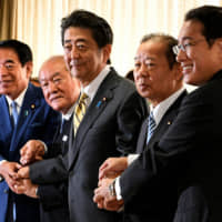 Abe shakes up LDP leadership, but retains key party heavyweights