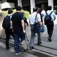 Japan paternity leave suit spotlights workers' rights