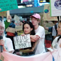 In Tokyo, some 2,800 students and environmental activists called on the city to revise its carbon emission reduction goals. | RYUSEI TAKAHASHI