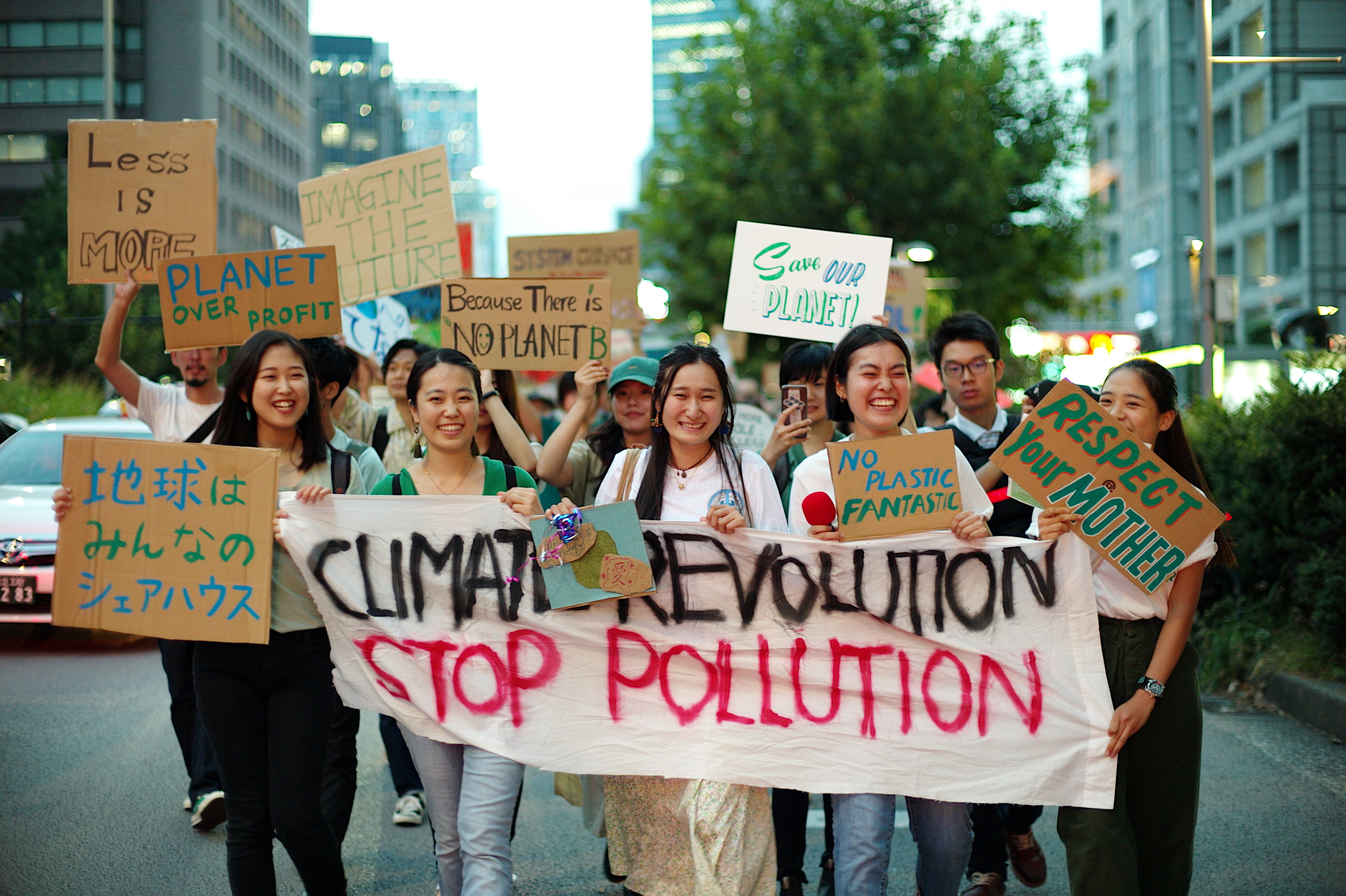 People march during a Fridays For Future event in Tokyo on Sept. 20. | RYUSEI TAKAHASHI