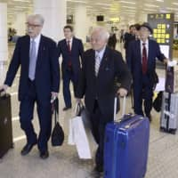 Hideki Miyazaki (left), a former Upper House member of the ruling Liberal Democratic Party, and senior officials from the Japan Medical Association arrive in Pyongyang on Saturday. | KYODO