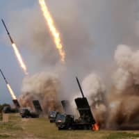 North Korean military personnel test-fire missiles at an unidentified location on May 4. Trajectories of some new-type short-range missiles were not tracked because of their irregular flight patterns, according to sources. | KCNA / VIA KYODO