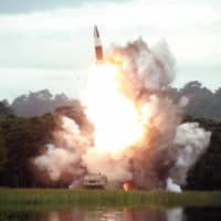 North Korea test-fires what it called 'a new-type of weapon' on Aug. 16 from an unidentified location. | KCNA / VIA KYODO