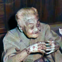 A centenarian woman with an Okinawan hand tattoo known as hajichi is seen in Naha in 1973. | THE OKINAWA TIMES