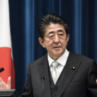 Prime Minister Shinzo Abe speaks during a news conference at his official residence in Tokyo on Wednesday after reshuffling his Cabinet. | BLOOMBERG