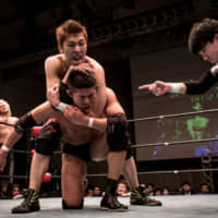Student wrestlers fight in the ring during the 2015 Student Pro-Wrestling Summit in Tokyo.   GETTY IMAGES / VIA BLOOMBERG