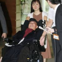 Upper House lawmaker and amyotrophic lateral sclerosis patient Yasuhiko Funago, of the anti-establishment Reiwa Shinsengumi party, leaves the Prime Minister's Office in Tokyo on Wednesday after meeting Prime Minister Shinzo Abe. | KYODO