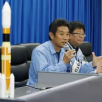 Atsutoshi Tamura, a Mitsubishi Heavy Industries Ltd. official in charge of Wednesday's rocket launch, gives details of a fire that broke out near the launch pad at the Tanegashima Space Center, in Kagoshima Prefecture, during a news conference the same day. | KYODO
