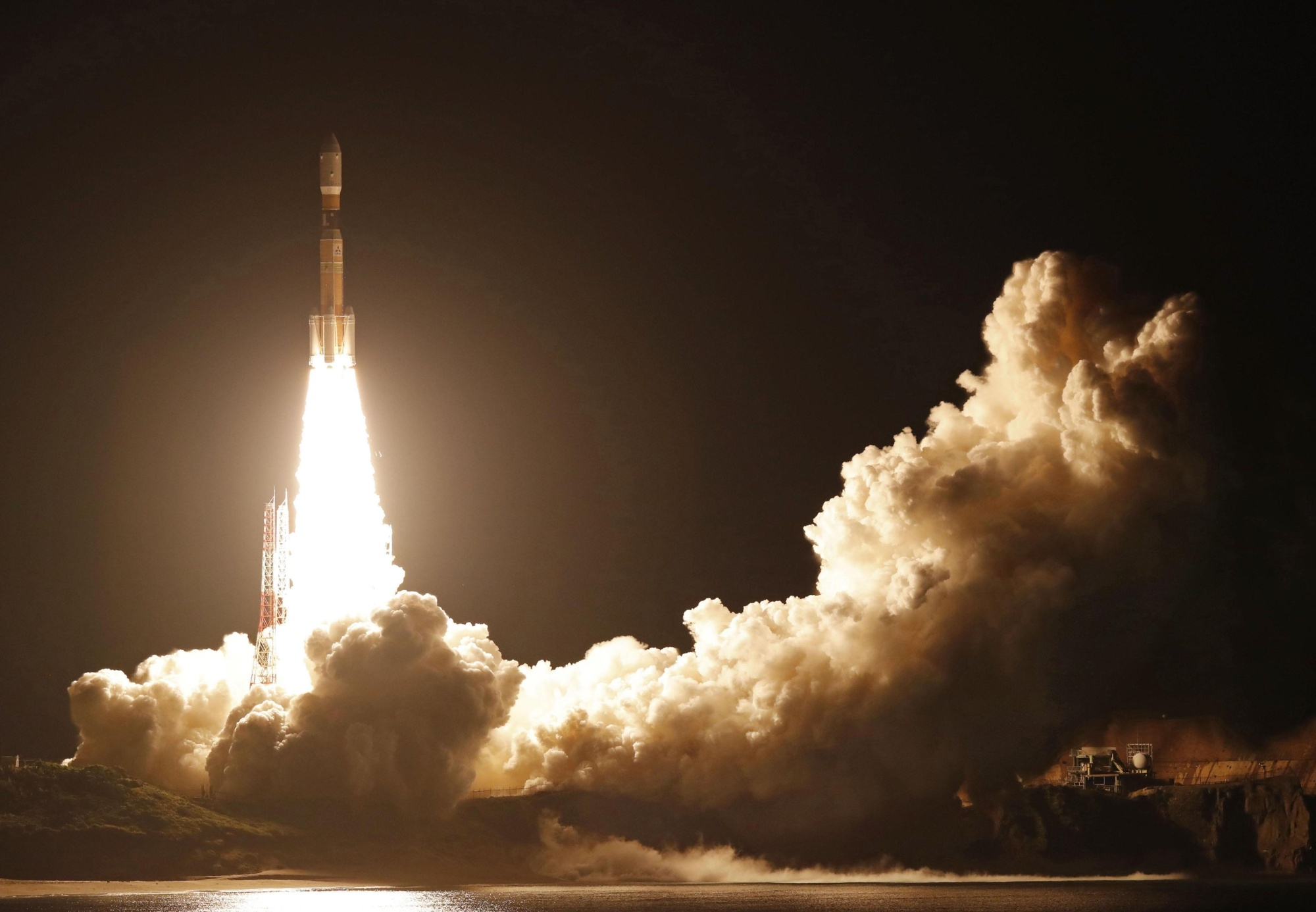 An H-IIB rocket is launched from Tanegashima Space Center in Kagoshima Prefecture early Wednesday. | KYODO
