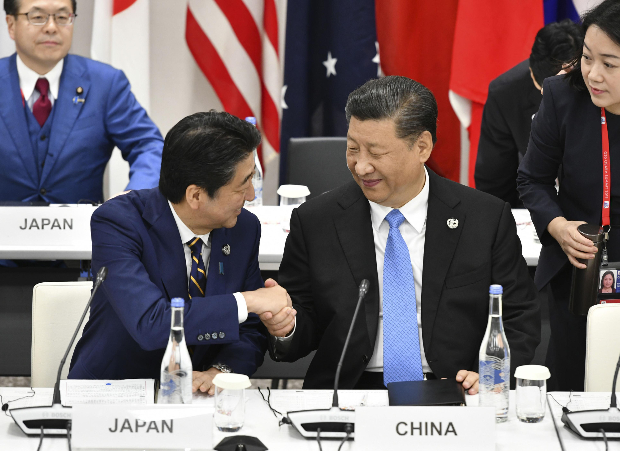 Prime Minister Shinzo Abe and Chinese leader Xi Jinping shake hands during the Group of 20 summit in Osaka on June 28. | KYODO