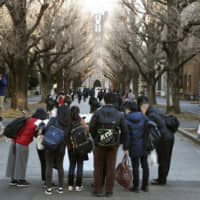 People gather before an entrance test at the University of Tokyo in January. | KYODO