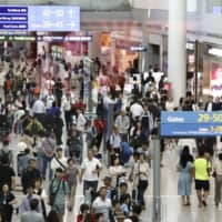 Travelers walk through Incheon International Airport in South Korea. Government data released Wednesday showed that the number of South Korean visitors to Japan fell by nearly half in August as Tokyo-Seoul relations continued to sour. | KYODO