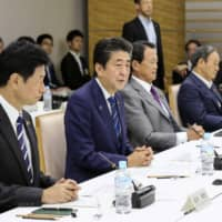 Abe vows to improve Japan's social welfare as population grays