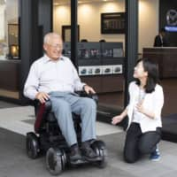 Firms promote electric wheelchairs as more Japanese turn in their driving permits