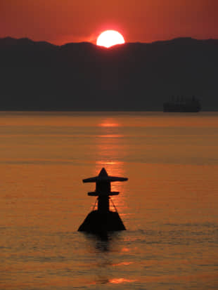 Stone on the water: A stone lantern appears to float of Shiraishi Island in the Seto Inland Sea during half-tide at sunset. | AMY CHAVEZ
