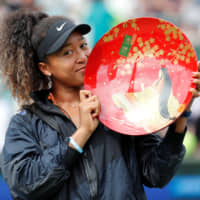 Better things to do: While A Masso performed a comedy set in which they suggested Naomi Osaka 'bleach' her skin, the tennis champion was busy winning the Pan Pacific Open in Osaka. | REUTERS