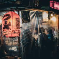 Ready to slurp: Customers pack the yatai (food stalls) serving ramen noodles in an area of Fukuoka. | GETTY IMAGES
