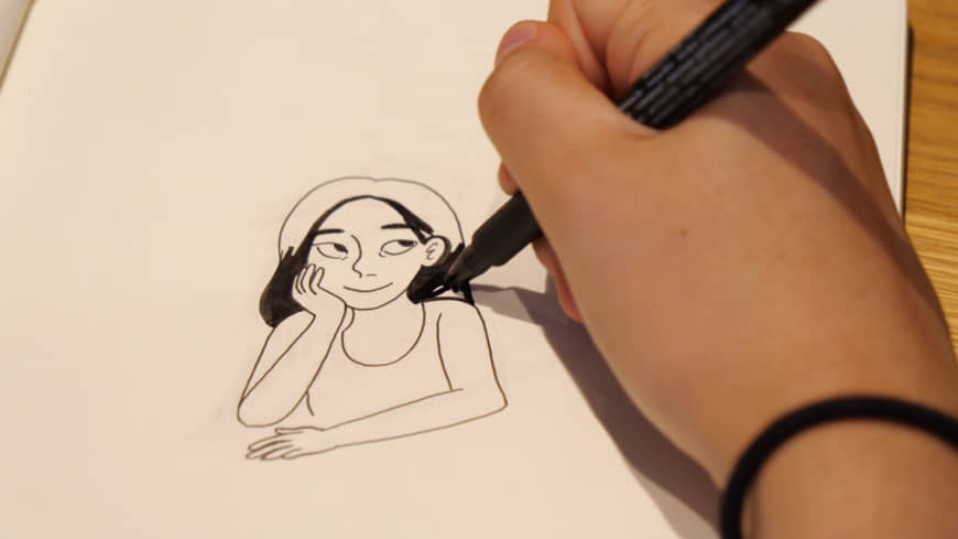 This is me: Christine Mari Inzer sketches a self-portrait at the offices of The Japan Times. | CHISATO TANAKA