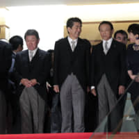 Prime Minister Shinzo Abe reshuffled his Cabinet on Wednesday, appointing allies to key positions as he nears becoming the country's longest-serving premier in November. | BLOOMBERG