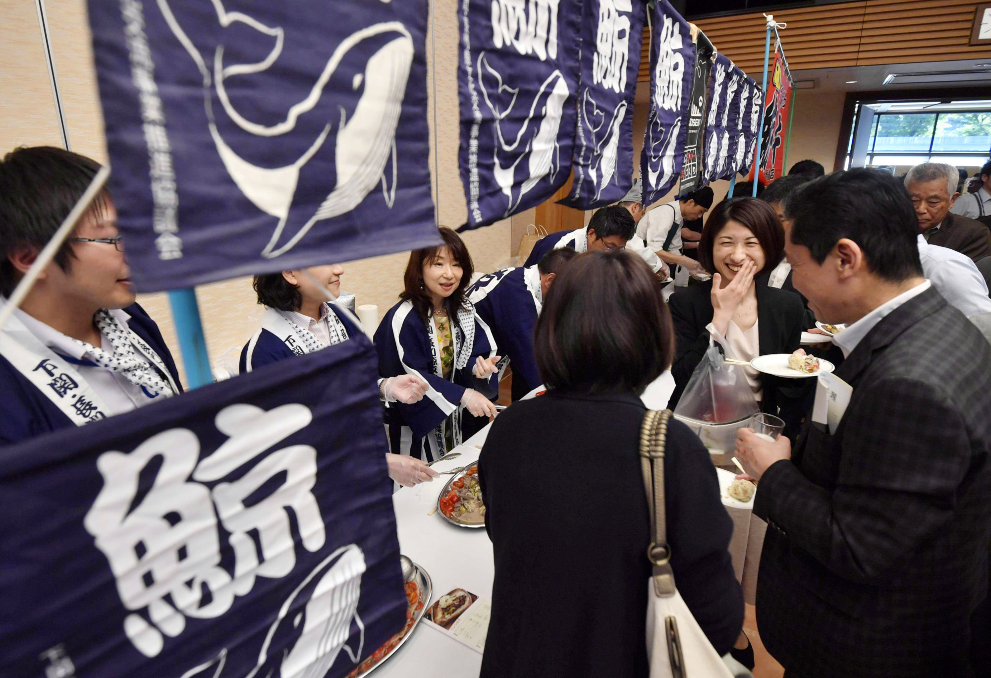 Members of a supra-partisan Diet group that seeks to protect whale cuisine enjoy whale dishes at a gathering in Tokyo on June 29.   KYODO