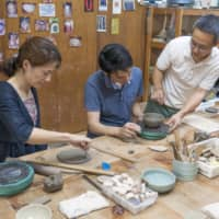 Mitsuo Murakami works with participants in one of his regular workshops. | STEPHEN MANSFIELD