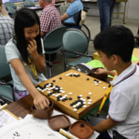 The summer camp organized by the Japan Go Association attracts players of all ages. | YOSHIAKI MIURA