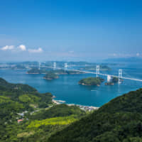 Adventure on two wheels: A great way to see the Setonaikai National Park is to rent a bicycle and cross the 70-kilometer-long Shimanami Kaido cycling route. | GETTY IMAGES