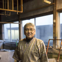 An ongoing legacy: In 1974, Akira Kubota began producing handmade Japanese paper using techniques taught to him by his father, Yasuichi. Akira wants his paper to reflect the nature of the Iwami countryside. Having inherited the skills of his ancestors, he keeps his focus on training the next generation of craftspeople who will carry on the Sekishu traditions. | MASASHI KUMA